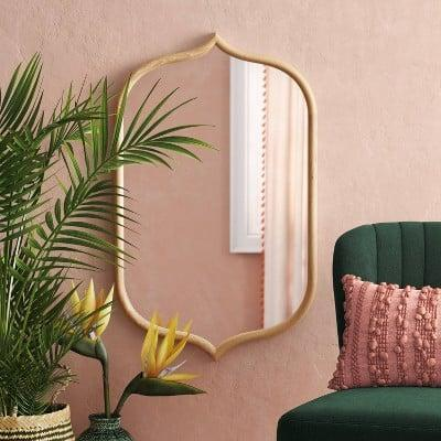 <p>Elevate any wall in your home with this eye-catching <span>Top and Bottom Peak Mirror</span> ($70).</p>