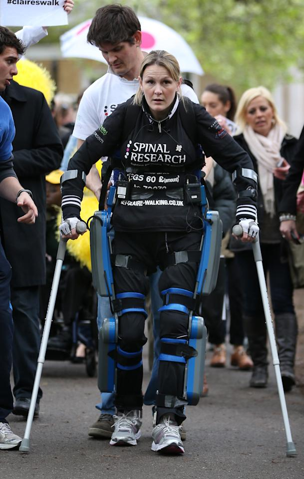LONDON, ENGLAND - MAY 08:  Claire Lomas walks the last mile of the Virgin London Marathon on May 8, 2012 in London, England. Ms Lomas, who is paralysed from the waist down after a riding accident in 2007, has taken 16 days to complete the 26.2 mile route. Starting out with 36,000 other runners she has averaged 2 miles a day with the help of a bionic ReWalk suit.  (Photo by Peter Macdiarmid/Getty Images)