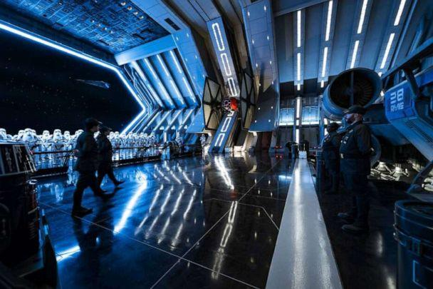 PHOTO: First Order troops and stormtroopers patrol the hangar bay of a Star Destroyer in Star Wars: Rise of the Resistance. Guests enter the hangar bay after their ship is caught in the Star Destroyer's tractor beam in this new Disney experience. (Matt Stroshane)