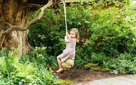 Princess Charlotte tries out the swing - Credit: Matt Porteous