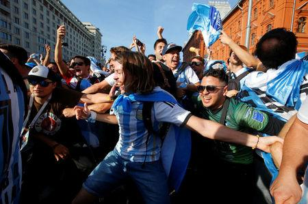 Supporters of the Argentine national soccer team cheer during a gathering in central Moscow