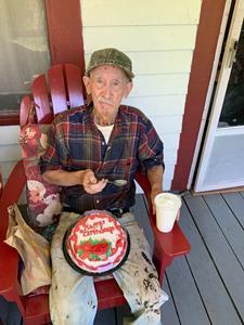 A caseworker helped Parsie celebrate his birthday during a socially-distanced porch visit.