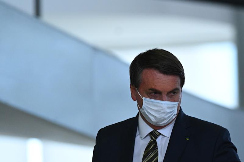 Jair Bolsonaro, Brazil's President arrives to attend the celebration ceremony of National Volunteer Day amid the coronavirus (COVID-19) pandemic at Planalto Palace in Brasilia, Brazil, on Aug. 28, 2020. (Photo by Andre Borges/NurPhoto via Getty Images)