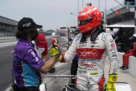 Pietro Fittipaldi, right, of Brazil, is congratulated by a crew member during qualifications for the Indianapolis 500 auto race at Indianapolis Motor Speedway, Saturday, May 22, 2021, in Indianapolis. (AP Photo/Darron Cummings)