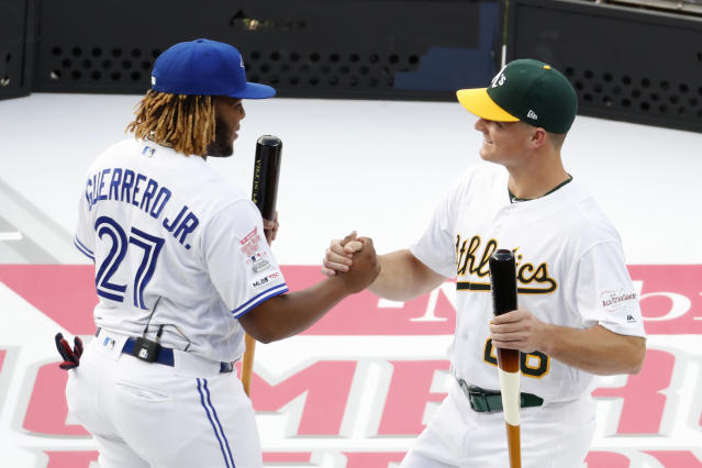 Vladimir Guerrero Jr., of the Toronto Blue Jays, and Matt Chapman, of the Oakland Athletics, are introduced during the Major League Baseball Home Run Derby, Monday, July 8, 2019, in Cleveland. The MLB baseball All-Star Game will be played Tuesday. (AP Photo/Ron Schwane)