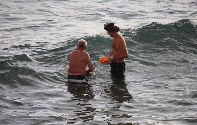 The baby is carried to shore by the father and a water birth specialist. Photo: Facebook/Hadia Hosny El Said