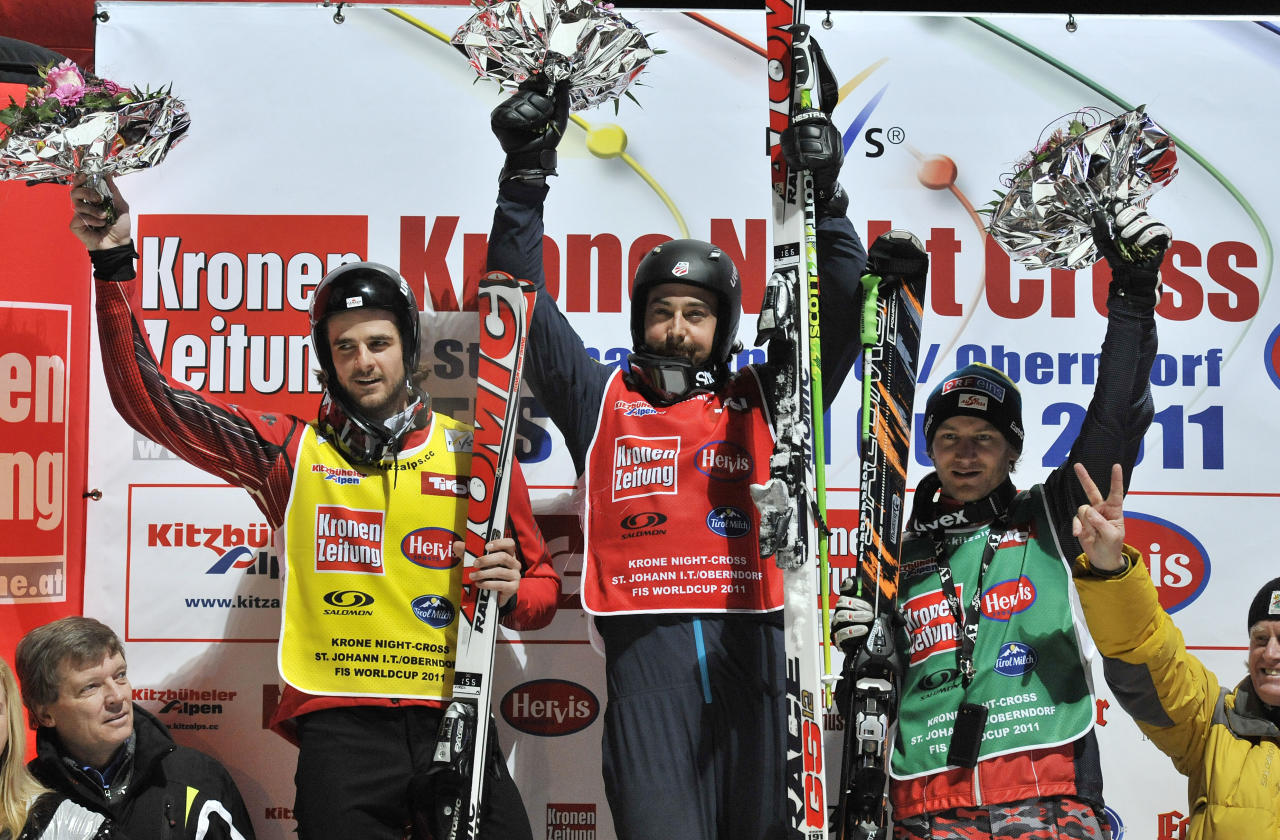 Second placed Nick Zoricic from Canada , left , winner John Teller, center, from the United States and Austria's Thomas Zangerl celebrate on the podium after the men's skicross final at the World Cup ski event in St. Johann in Tyrol, Austria , Friday, Jan. 7, 2011.