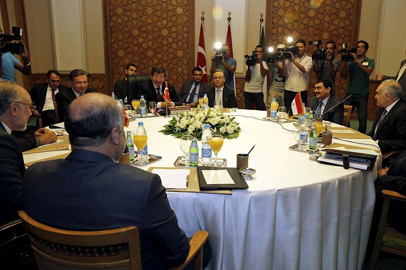 "Foreign ministers from three of the four-nation ""Islamic Quartet"" gather for the first time for dialogue on Syria's civil war, in an initiative launched by Egypt's new Islamist president Mohammed Morsi, at the foreign ministry in Cairo, Egypt, Monday, Sept. 17, 2012. Iran's Foreign Minister Ali Akbar Salehi, left, Turkish Foreign Minister Ahmet Davutoglu, center left, and Egyptian Foreign Minister Mohamed Kamel Amr, right, met late Monday. Notably absent is Saudi's Foreign Minister Prince Saud al-Faisal, who is recovering from abdominal surgery. (AP Photo/Sami Wahib)"