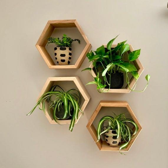 "<br><br><strong>craftedglorydesign</strong> Honeycomb Shelves, $, available at <a href=""https://go.skimresources.com/?id=30283X879131&url=https%3A%2F%2Fwww.etsy.com%2Flisting%2F682203187%2Fhoneycomb-shelves-hexagon-shelves"" rel=""nofollow noopener"" target=""_blank"" data-ylk=""slk:Etsy"" class=""link rapid-noclick-resp"">Etsy</a>"