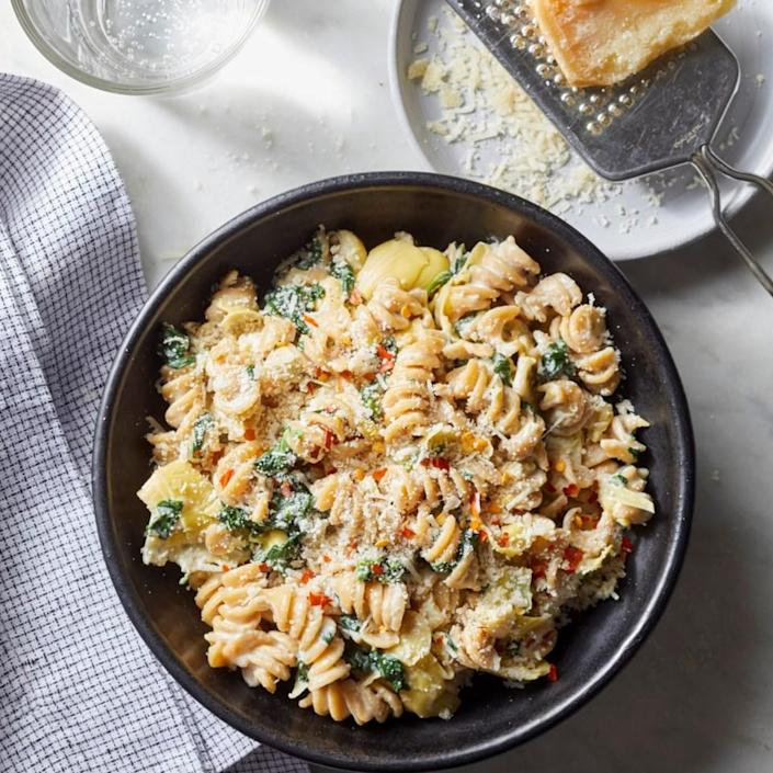 <p>If you've ever wanted to make a meal out of warm spinach and artichoke dip, this creamy pasta is for you. And here's what's almost as good as the flavor of this comforting dish: the fact that this healthy dinner takes just 20 minutes to prepare.</p>