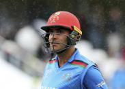 Afghanistan's Hashmatullah Shahidi leaves the pitch after rain stops play during the ICC Cricket World Cup group stage match between Afghanistan and New Zeland, at the County Ground Taunton, England, Saturday, June 8, 2019. (Mark Kerton/PA via AP)