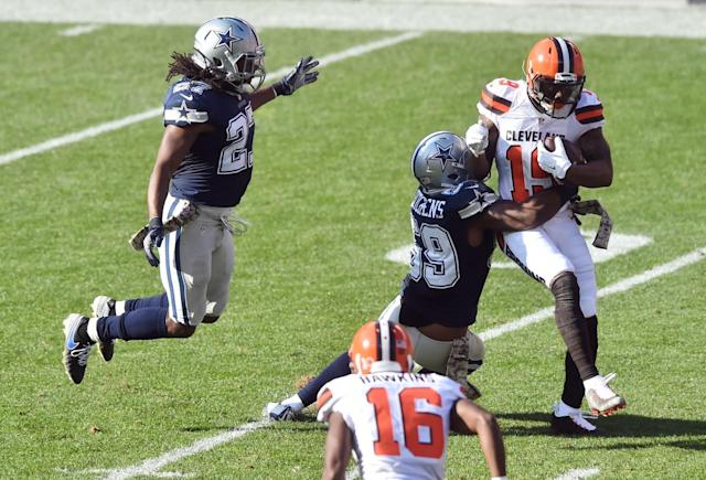 <p>Dallas Cowboys free safety J.J. Wilcox (27) and middle linebacker Anthony Hitchens (59) converge on Cleveland Browns wide receiver Corey Coleman (19) during the second quarter at FirstEnergy Stadium. Mandatory Credit: Ken Blaze-USA TODAY Sports </p>