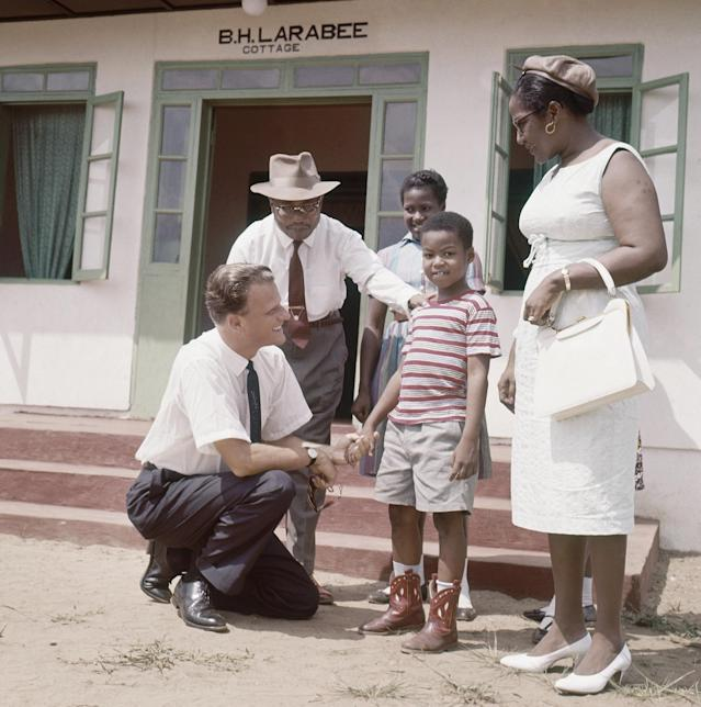 <p>Billy Graham meets children at Virginia Village, 20 miles from Monrovia, Liberia, in 1960. (Photo: AP) </p>