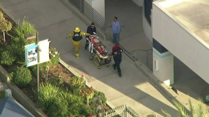 In this photo from video provided by KTLA-TV paramedics transport an injured person after a shooting at Saugus High School in Santa Clarita, Calif., early Thursday, Nov. 14, 2019. (KTLA-TV via AP)