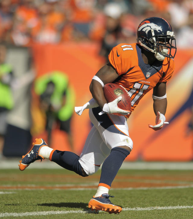 Denver Broncos wide receiver Trindon Holliday (11) runs back a kick-off return 105 yards for a touchdown against the Philadelphia Eagles in the first quarter of an NFL football game, Sunday, Sept. 29, 2013, in Denver. (AP Photo/Jack Dempsey)