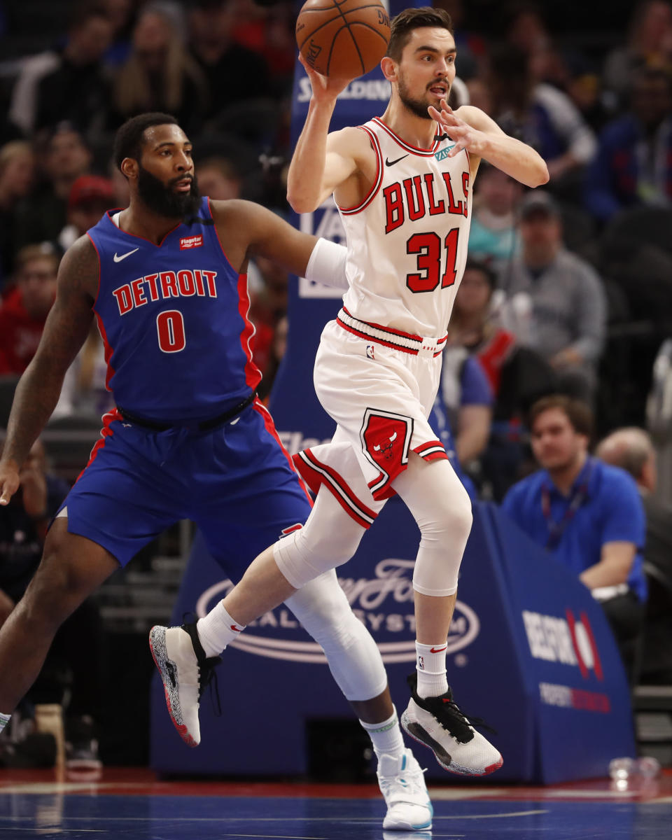 Chicago Bulls guard Tomas Satoransky (31) passes next to Detroit Pistons center Andre Drummond (0) during the first half of an NBA basketball game, Saturday, Jan. 11, 2020, in Detroit. (AP Photo/Carlos Osorio)