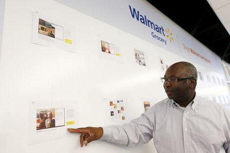 Michael Bender, chief operating officer of Wal-Mart's e-commerce operations, points at a wall of customer responses during a media tour of Wal-Mart's e-commerce facilities in San Bruno, California, April 11, 2016. REUTERS/Stephen Lam