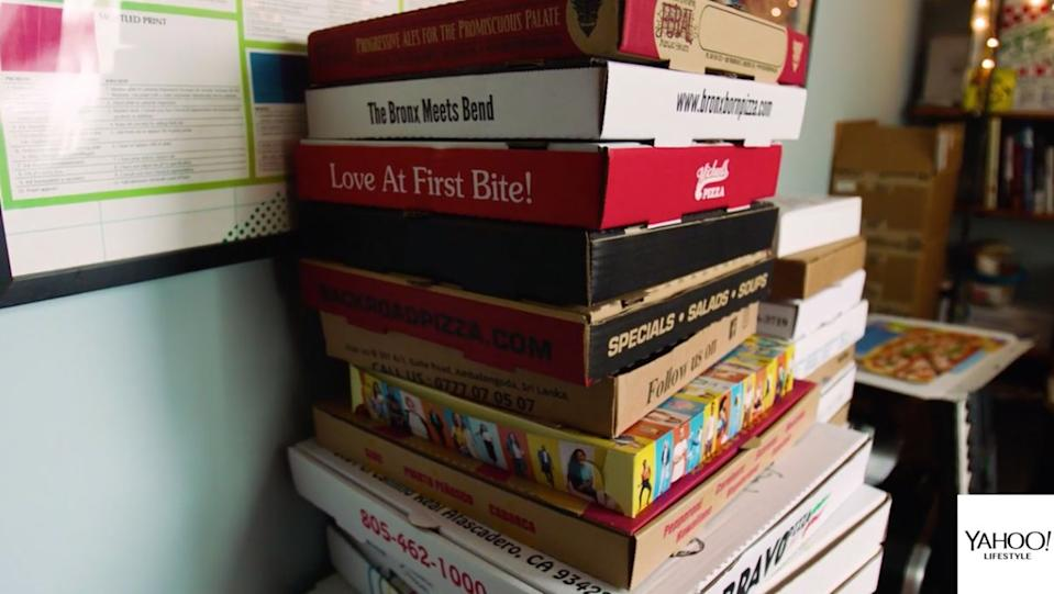 Just a few of Wiener's thousands of pizza boxes from around the world. (Photo: Yahoo Lifestyle)