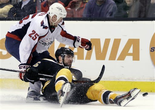 Washington Capitals left wing Jason Chimera (25) dumps Boston Bruins defenseman Johnny Boychuk to the ice and is called for a penalty during the third period of Game 7 of an NHL hockey Stanley Cup first-round playoff series, in Boston on Wednesday, April 25, 2012. (AP Photo/Elise Amendola)