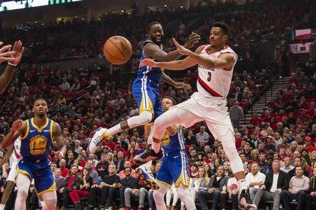 May 20, 2019; Portland, OR, USA; Portland Trail Blazers guard CJ McCollum (3) passes the ball against Golden State Warriors forward Draymond Green (23) during the first half in game four of the Western conference finals of the 2019 NBA Playoffs at Moda Center. Mandatory Credit: Troy Wayrynen-USA TODAY Sports