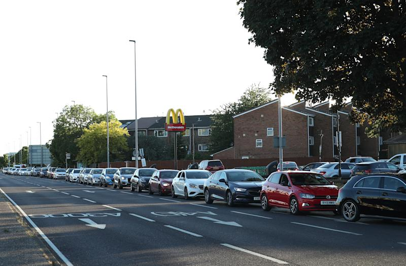 Cars queue at the McDonald's drive-thru in Hounslow. Source: PA via AAP