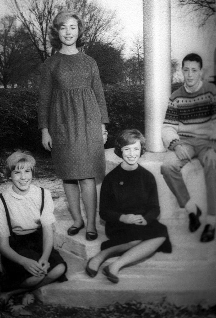 <p>Hillary Rodham, standing, poses with classmates at Park Ridge East High School, in Park Ridge, Ill., in a 1964 yearbook photo. She was junior class vice-president. (Photo: AP)</p>