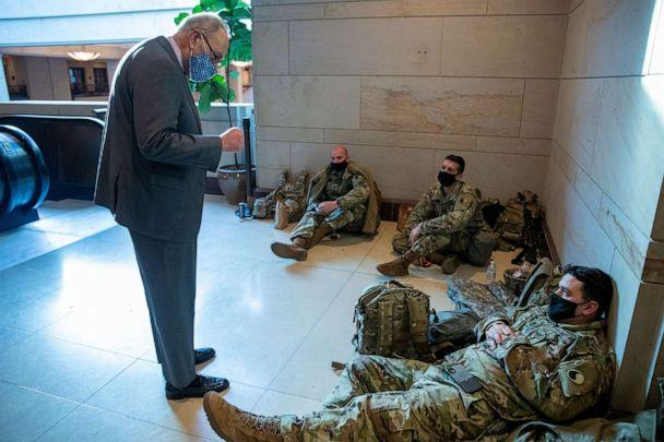 PHOTO: Senate Majority Leader Chuck Schumer greets National Guard soldiers inside the Capitol Visitors Center, Jan. 22, 2021, at the U.S. Capitol in Washington, D.C. (Shawn Thew/EPA via Shutterstock)