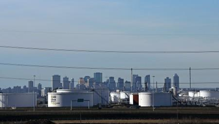 Crude oil storage tanks at Enbridge's facility in Sherwood Park are seen against the skyline of Edmonton