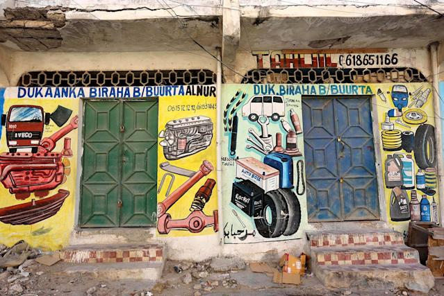 <p>A mural showing spare parts for vehicles is seen on a wall of a shop in Hodan district of Mogadishu, Somalia, June 10, 2017. (Photo: Feisal Omar/Reuters) </p>
