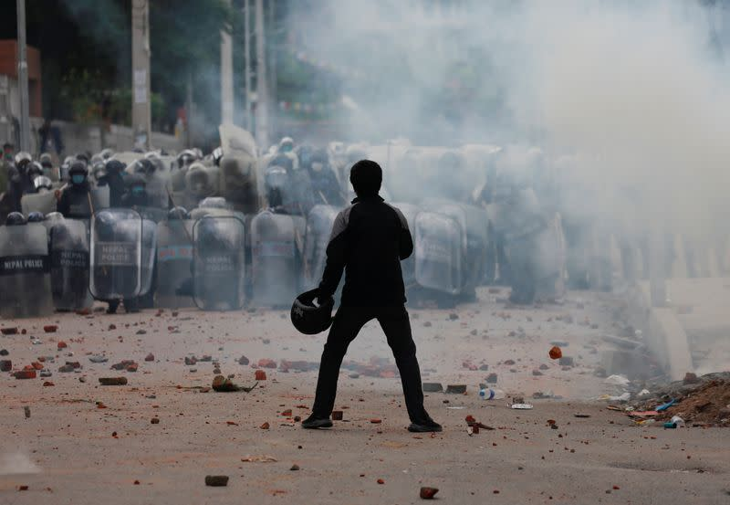 Nepal police fire tear gas to stop religious rally amid COVID-19 surge