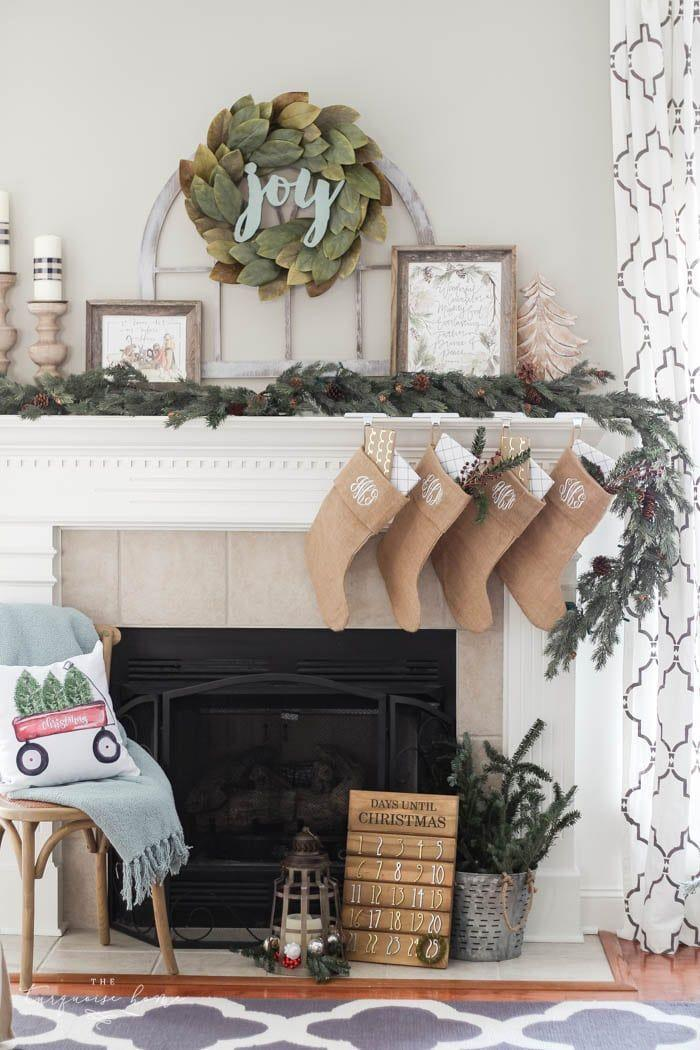 "<p>Want to expand your horizons this year? Instead of an evergreen wreath, try putting one made of magnolia leaves above your mantel. To add a little holiday spirit, nestle a wooden sign—like one that says ""joy"" or ""peace""—in the middle. </p><p><em>See more at <a href=""https://theturquoisehome.com/magnolia-wreath-christmas-mantel-decor/"" rel=""nofollow noopener"" target=""_blank"" data-ylk=""slk:The Turquoise Home"" class=""link rapid-noclick-resp"">The Turquoise Home</a>.</em></p><p><a class=""link rapid-noclick-resp"" href=""https://www.amazon.com/Nearly-Natural-Magnolia-Wreath-Green/dp/B015GKNPPU?tag=syn-yahoo-20&ascsubtag=%5Bartid%7C10072.g.34484299%5Bsrc%7Cyahoo-us"" rel=""nofollow noopener"" target=""_blank"" data-ylk=""slk:SHOP WREATH"">SHOP WREATH</a></p>"
