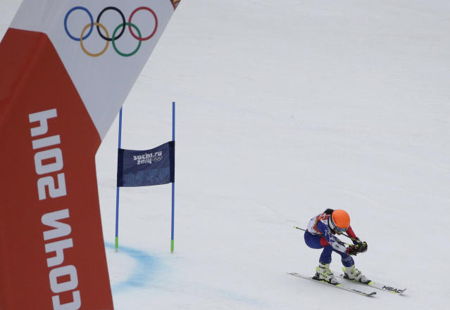Violinst Vanessa Mae, starting under her father's name as Vanessa Vanakorn for Thailand, finishes the first run in the women's giant slalom at the Sochi 2014 Winter Olympics, Tuesday, Feb. 18, 2014, in Krasnaya Polyana, Russia. (AP Photo/Gero Breloer)