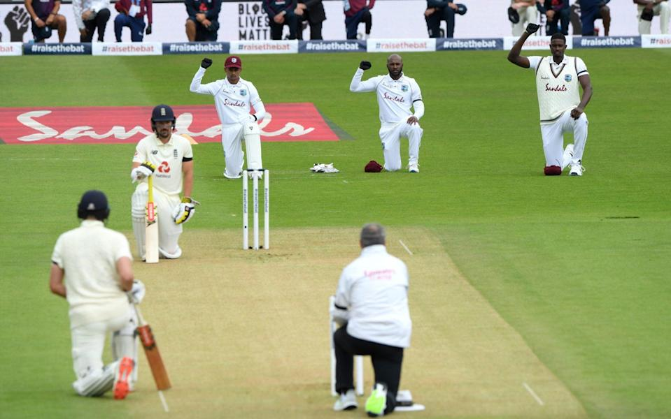 Both sides took a knee before each match between England and West Indies - GETTY IMAGES
