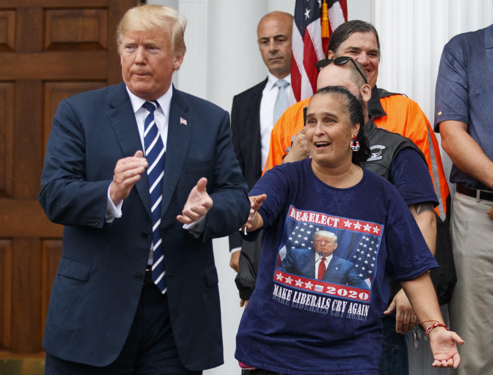 President Donald Trump is cheered by members of Bikers for Trump and supporters, Saturday, Aug. 11, 2018, at the clubhouse of Trump National Golf Club in Bedminster, N.J. (AP Photo/Carolyn Kaster)