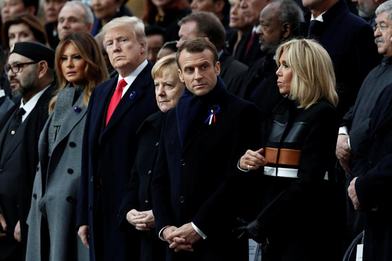 U.S. President Donald Trump and first lady Melania Trump; German Chancellor Angela Merkel; andFrench President Emmanuel Macron and his wife, Brigitte Macron, attend Sunday's commemoration of Armistice Day at the Arc de Triomphe in Paris. (Reuters)