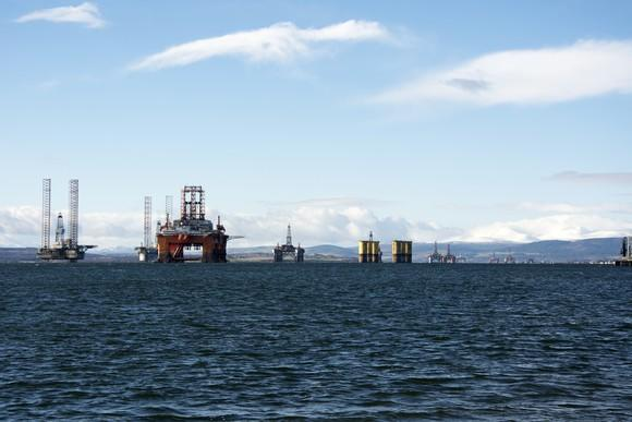 A line of idled offshore drilling rigs.