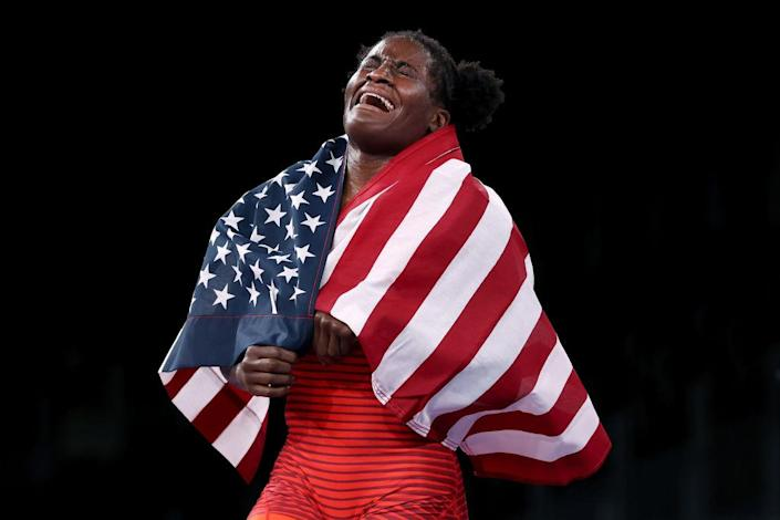 """Tamyra Mariama Mensah-Stock of Team USA celebrates defeating Blessing Oborududu of Team Nigeria during the Women's Freestyle 68kg Gold Medal Match on day eleven of the Tokyo Olympics at Makuhari Messe Hall on Aug. 03, 2021 in Chiba, Japan.<span class=""""copyright"""">Tom Pennington—Getty Images</span>"""