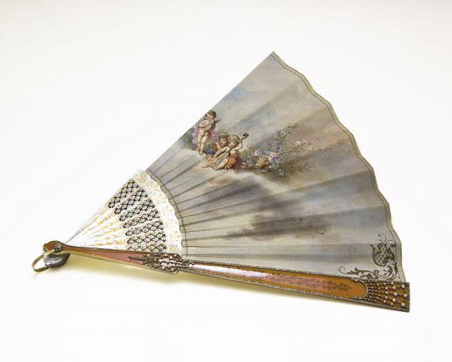 """An Elisabeth Balletta fan by Faberge workmaster August Holmstrom is shown in this undated photo from the Houston Museum of Natural Science. The fan is on display at the museum as part of the largest private collection in the United States of items from the Russian artisan Peter Carl Faberge. Featuring more than 350 objects, the exhibit """"Fabergé: A Brilliant Vision,"""" runs through Dec. 31, 2013 at the Houston Museum of Natural Science. (AP Photo/Houston Museum of Natural Science)"""