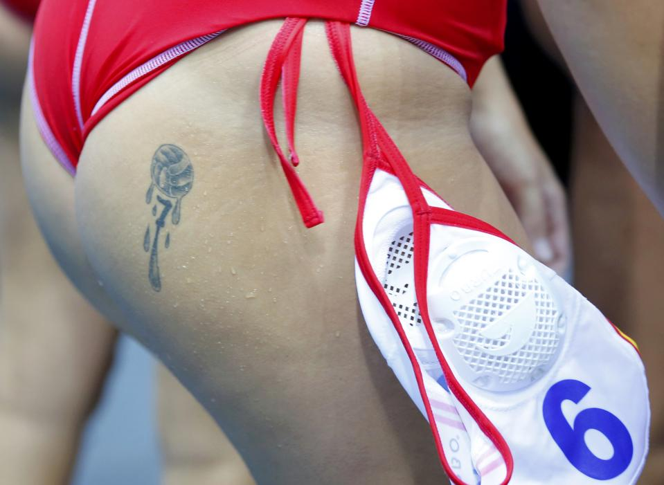 Tattoo is seen on Spain's Andrea Blas Martinez during their women's water polo quarterfinal round against Great Britain at the Water Polo Arena during the London 2012 Olympic Games August 5, 2012. REUTERS/Laszlo Balogh (BRITAIN - Tags: SPORT OLYMPICS SPORT WATER POLO)
