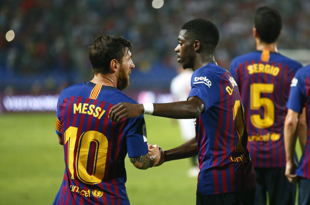 Barcelona's Ousmane Dembele celebrates with Lionel Messi, left, after scoring his side's second goal during the Spanish Super Cup soccer match between Sevilla and Barcelona in Tangier, Morocco, Sunday, Aug. 12, 2018. (AP Photo/Mosa'ab Elshamy)