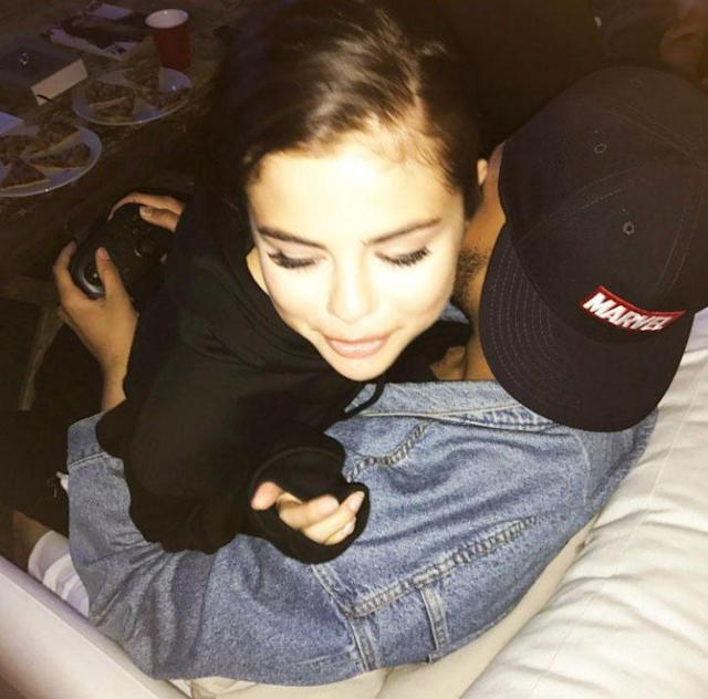 "<p>Selena Gomez and video games … what more does the Weeknd need? The ""Starboy"" singer shared a pic on his Instagram story of himself cuddling with his girlfriend while holding a controller. Talk about a good multitasker! <a href=""https://www.yahoo.com/celebrity/apos-home-apos-weeknd-cuddles-202455492.html"" data-ylk=""slk:He wrote simply, ""Home,"" across the photo"" class=""link rapid-noclick-resp"">He wrote simply, ""Home,"" across the photo</a>. <i>Aww</i>. (Photo: The Weeknd via Instagram) </p>"