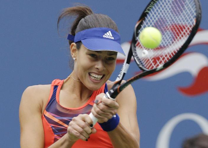 Ana Ivanovic, of Serbia, returns a shot to Victoria Azarenka, of Belarus, during the quarterfinals of the 2013 U.S. Open tennis tournament, Tuesday, Sept. 3, 2013, in New York. (AP Photo/Julio Cortez)