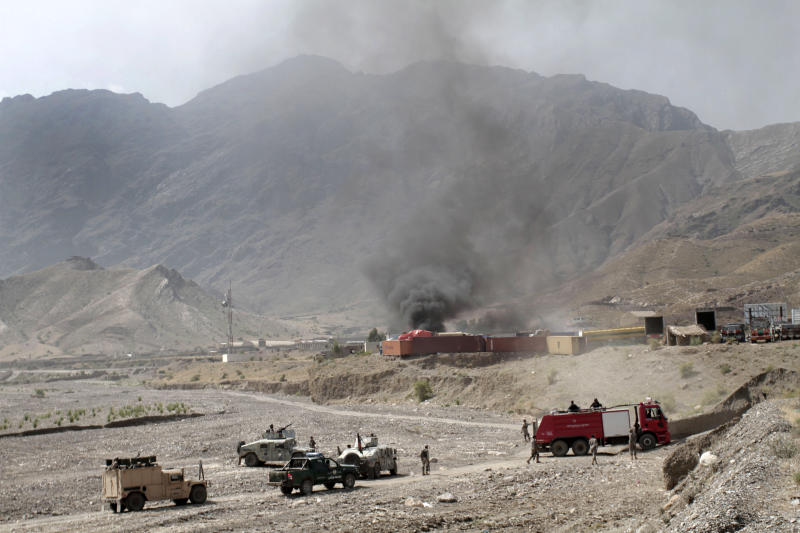 Afghan border police and firefighters arrive to the scene of an attack by militants on a U.S. base in the Torkham area near the Pakistan--Afghanistan border in Jalalabad province east of Kabul, Afghanistan, Monday, Sept. 2, 2013. The Taliban claimed responsibility for the strike on a U.S. base in Afghanistan near the border with Pakistan on Monday, setting off bombs, torching vehicles and shutting down a key road used by NATO supply trucks, officials said. Several people -- apparently all attacking insurgents -- were killed. (AP Photo/Rahmat Gul)