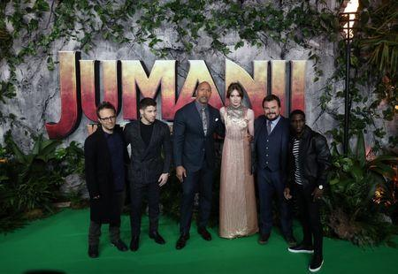 Director Jake Kasdan and cast members Nick Jonas, Dwayne Johnson, Karen Gillan, Jack Black and Kevin Hart pose for photographers as they arrive for the  UK premiere of 'Jumanji: Welcome to the Jungle', at the Vue West End, Leicester Square, central London