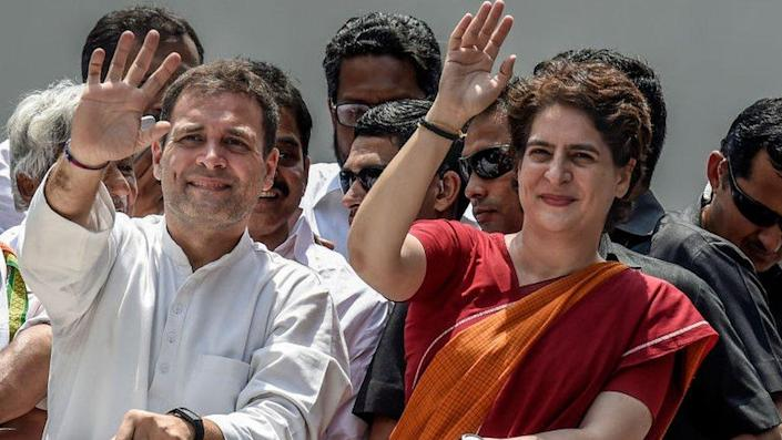 Rahul Gandhi and Priyanka Gandhi wave at the crowd in the road show after Rahul Gandhi filing nominations from Wayanad district on April 4, 2019.