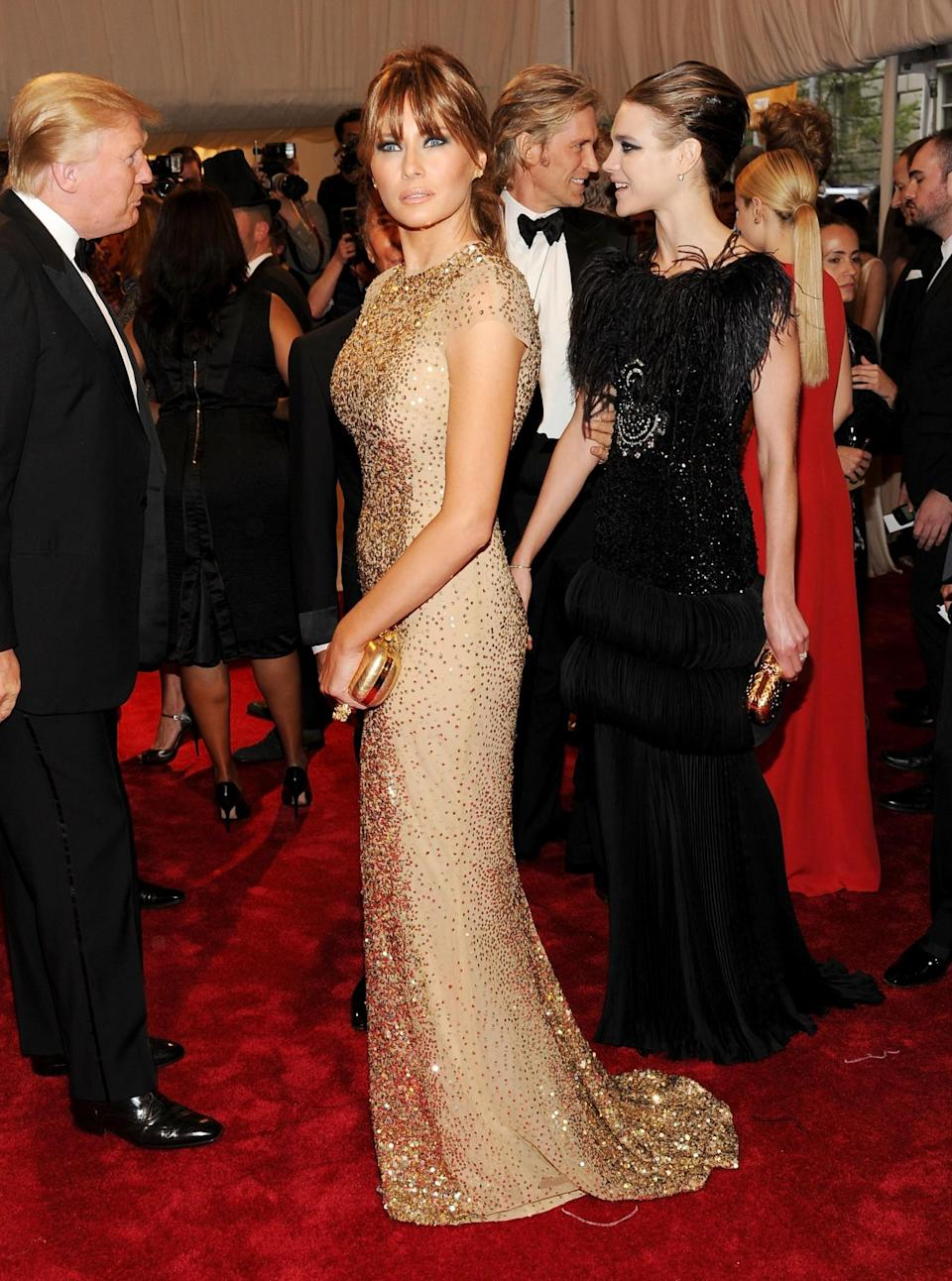 <p>Melania opted for a sequinned golden dress by Reem Acra for the 2011 Met Gala celebrating Alexander McQueen. Her accessories were by none other than McQueen. <i>[Photo: Getty]</i> </p>