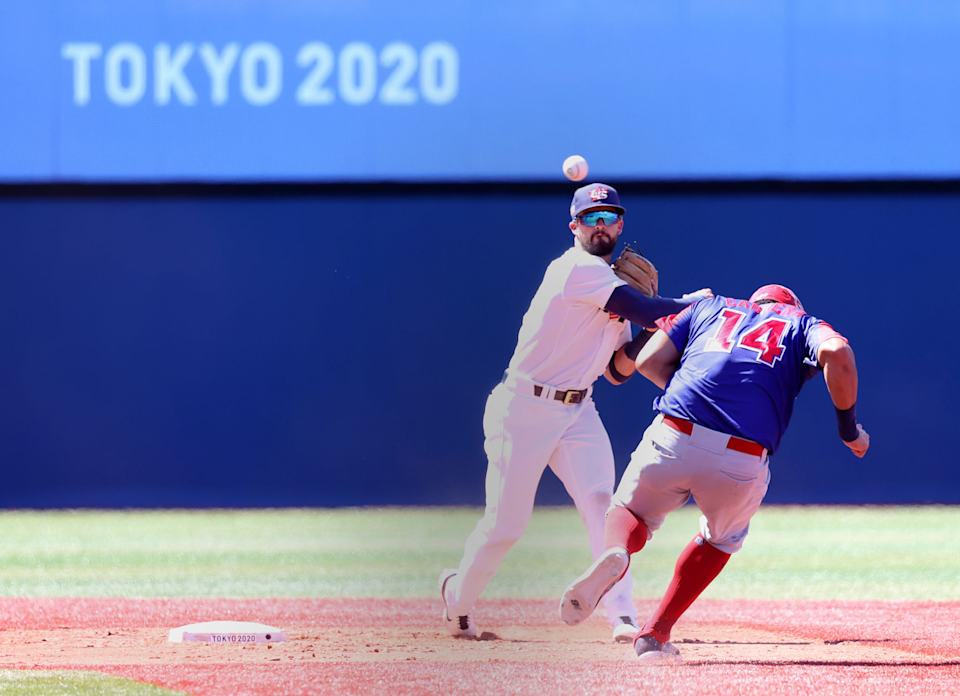 Eddy Alvarez throws to first base against the Dominican Republic during the Tokyo Olympics.