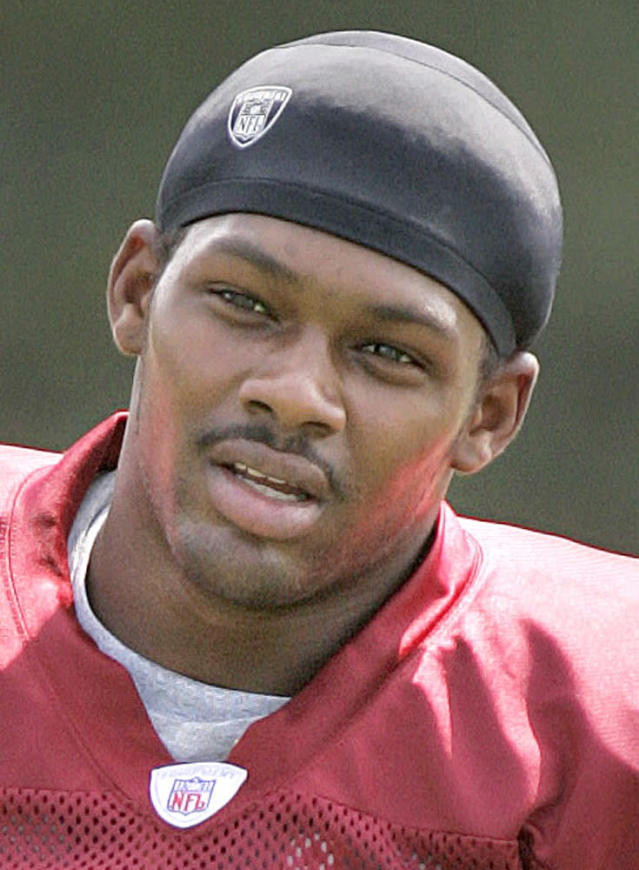 FILE - In this Aug. 24, 2005 file photo, Washington Redskins football player Sean Taylor is shown at training camp in Ashburn, Va. A judge in Miami has set an April 16 trial date for the alleged shooter in the 2007 killing of Taylor. Four men accused in the slaying will be tried separately. The judge said Friday that the first to stand trial will be 21-year-old Eric Rivera Jr. (AP Photo/Lawrence Jackson, File)