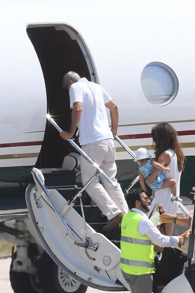 George Clooney boarding a plane to leave Sardinia on July 12 following his motorbike crash. His elbow appeared to have bruises and cuts on it, though it's unclear if they were related to the crash. (Photo: Backgrid)