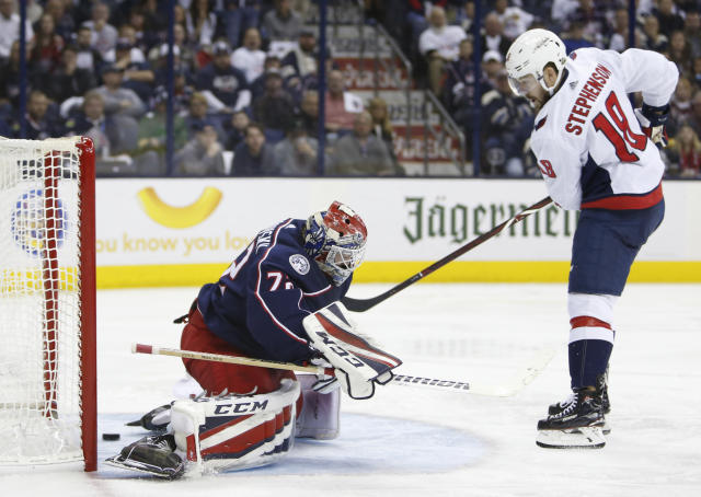 Washington Capitals' Chandler Stephenson, right, scores against Columbus Blue Jackets' Sergei Bobrovsky, of Russia, during the third period of Game 6 of an NHL first-round hockey playoff series Monday, April 23, 2018, in Columbus, Ohio. The Capitals defeated the Blue Jackets 6-3. (AP Photo/Jay LaPrete)